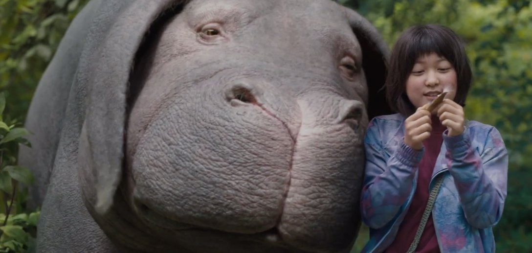 Okja creature with young girl