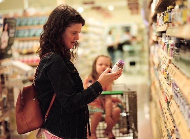 Grocery shopper reading label