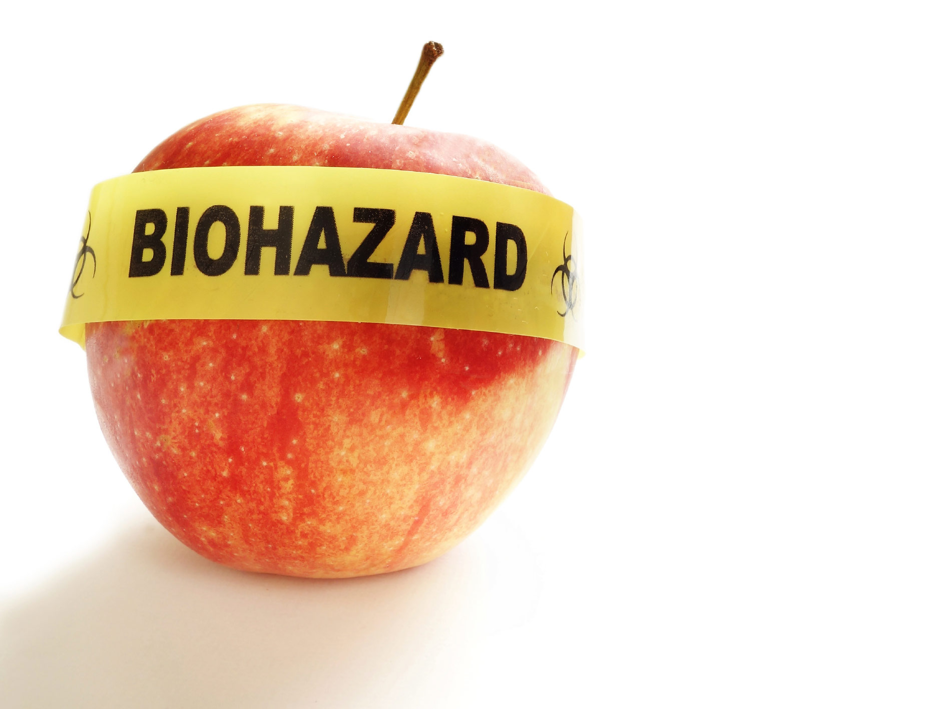 Red apple with yellow Biohazard tape