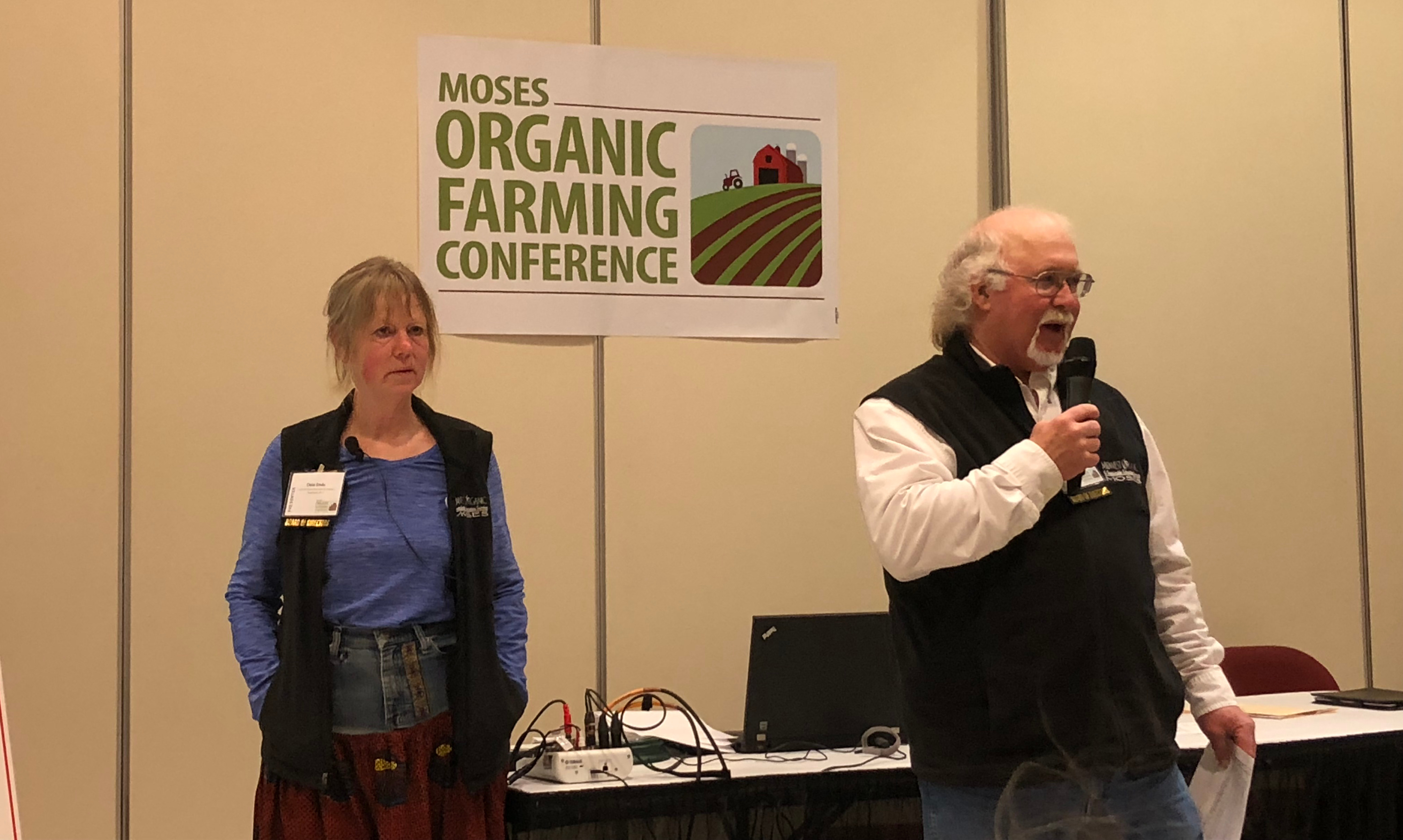 Organic farmers Dela Ends and Charlie Johnson at conference