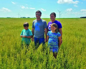 Blair family in oat field