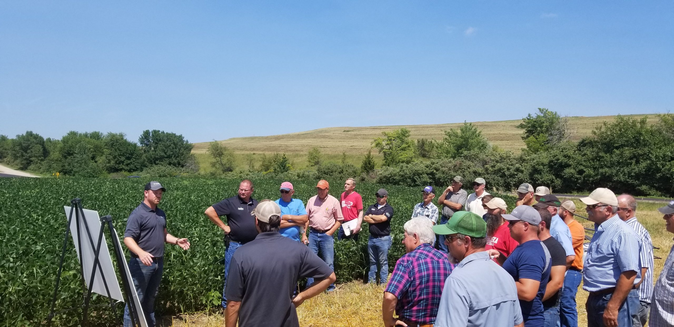 AgriSecure founder Bryce Irlbeck speaks to farmers at an organic field day