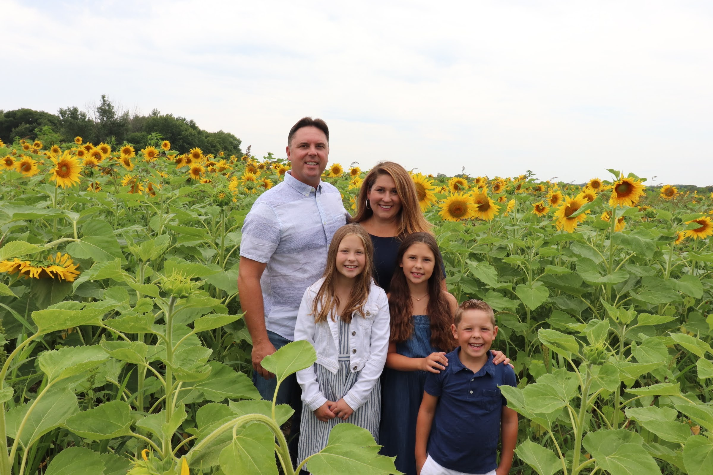 Photo of John Strohfus and family in sunflower field